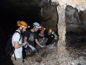 Dr. Brauer with students in a cave