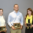 3 minute thesis competition winners with award plaques