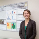 Tara Early with research poster